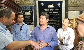 Minister vows to return evicted Jews to Hevron