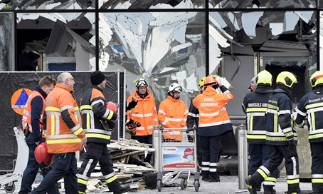 Emergency workers at the site of Brussels airport bombing