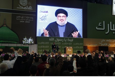 Nasrallah addresses supporters from a screen