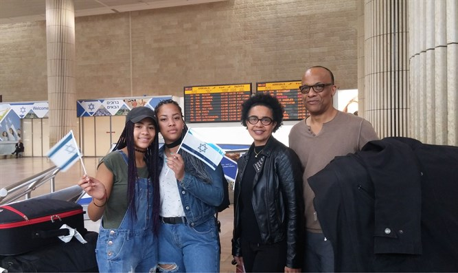George and Amy Camara and two of their four children arriving in Israel, Nov. 2, 2016