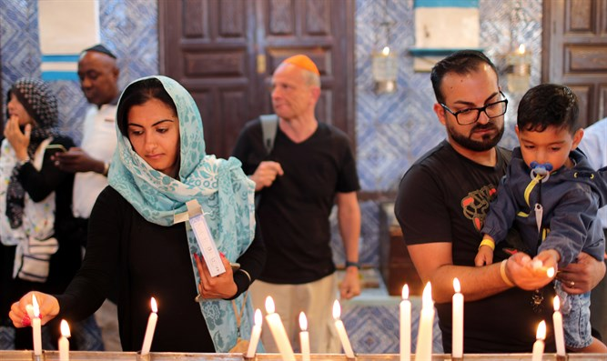 Worshippers light candles inside Ghriba synagogue in Djerba